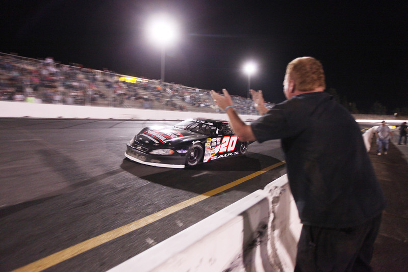 Puyallup, Wash. resident and Driver Jay Sauls (20) is cheered on after winning the Spokane 200, at the Spokane County Raceway oval track, in Airway Heights, Wash., on Saturday, August 25, 2012. (Young Kwak/The Pacific Northwest Inlander)