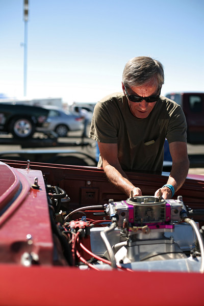 Tonasket, Wash. resident Jerry Saune works on his his Pro Class 1964 Plymouth Savoy before racing at the Spokane County Raceway drag strip, in Airway Heights, Wash., on Saturday, August 25, 2012. (Young Kwak/The Pacific Northwest Inlander)