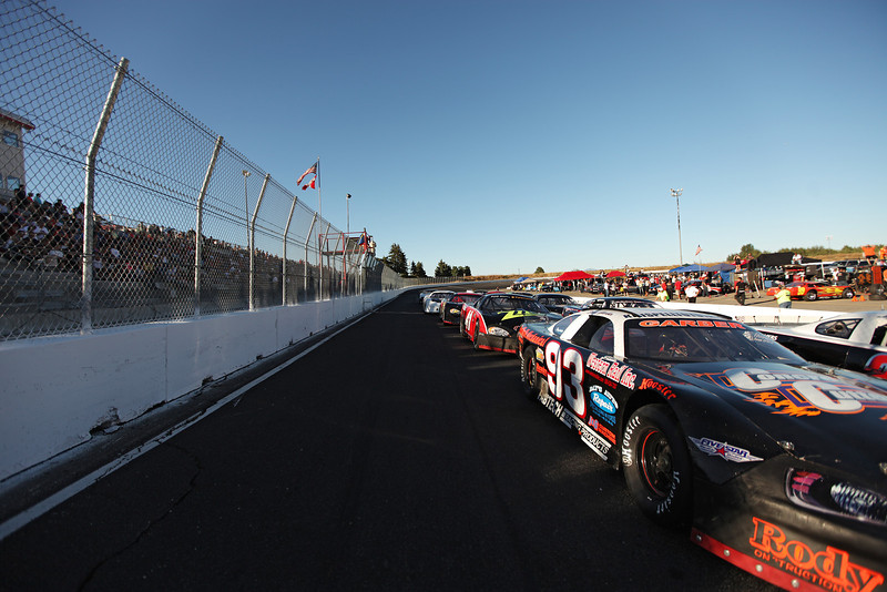 Vehicles line up for a heat before the Spokane 200, at the Spokane County Raceway oval track, in Airway Heights, Wash., on Saturday, August 25, 2012. (Young Kwak/The Pacific Northwest Inlander)