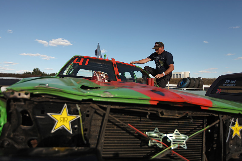 Bump To Pass driver Gary Cosby prepares his 1980 Impala Station Wagon, with a Chevy 350 engine, for a practice run at the Spokane County Raceway oval racetrack, in Airway Heights, Wash., on Friday, August 24, 2012. (Young Kwak/The Pacific Northwest Inlander)