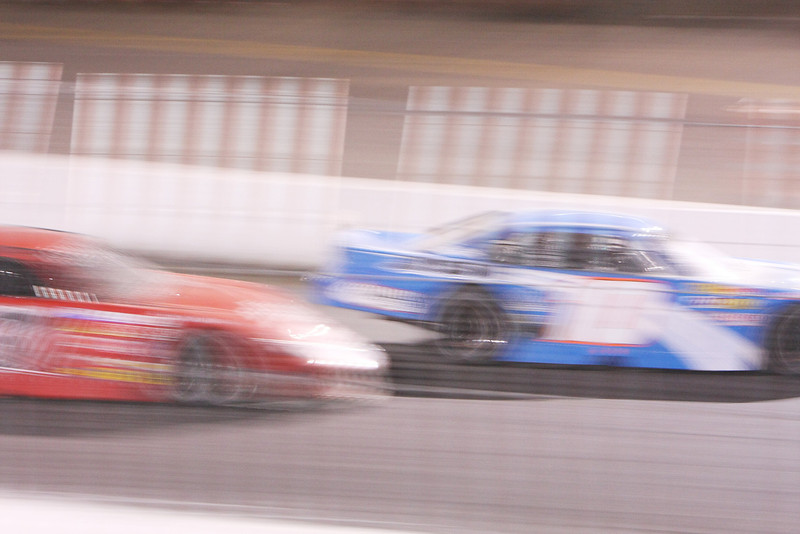Owen Riddle (10), right and Mike Longton (37) race during the Spokane 200, at the Spokane County Raceway oval track, in Airway Heights, Wash., on Saturday, August 25, 2012. (Young Kwak/The Pacific Northwest Inlander)