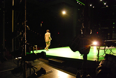 From the wings—where the actors wait to go on stage—we view Georges alone.