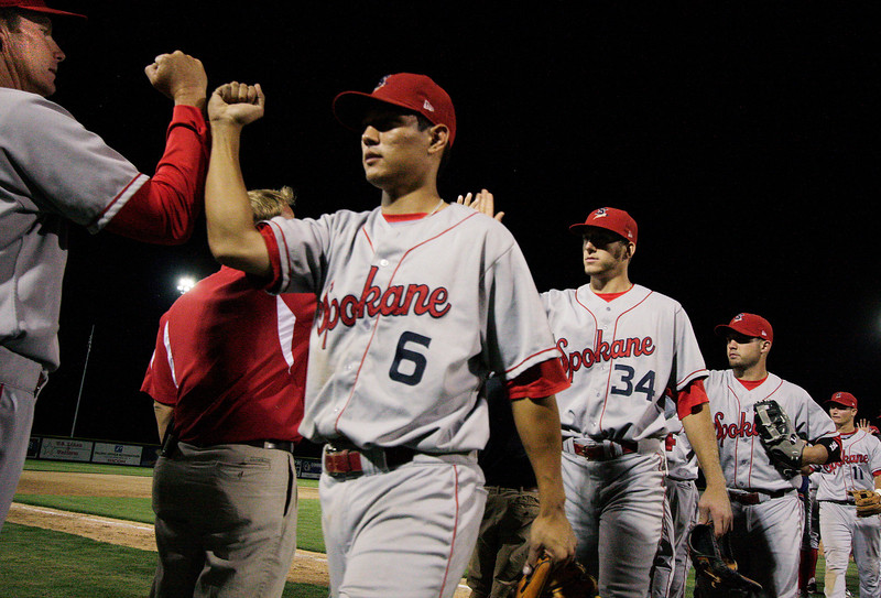 Spokane Indians second baseman Jason Ogata, left, short stop Edward Concel and the rest of the team congrat each other after a 13-9 victory against the Tri-City Dust Devils in a Northwest Leage at Gesa Stadium, in Pasco, Wash., Monday, August 4, 2008. (Young Kwak Special to the Pacific Northwest Inlander)