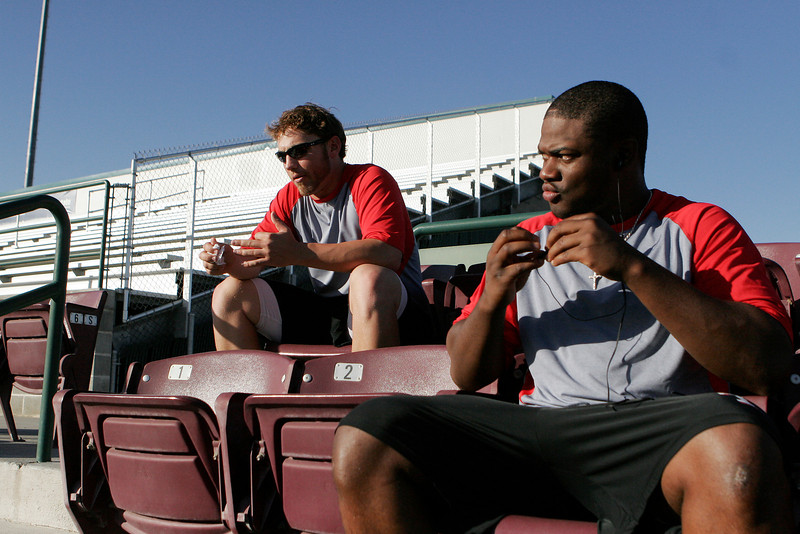 SPokane Indians pitcher Ryan Schlecht, left, and outfielder Eric Fry take a break before a Northwest League game against the Tri-City Dust Devils at Gesa Stadium, in Pasco, Wash., Monday, August 4, 2008. The Spokane Indians beat the Tri-City Dust Devils 13-9 that evening in a Northwest League game. (Young Kwak Special to the Pacific Northwest Inlander)