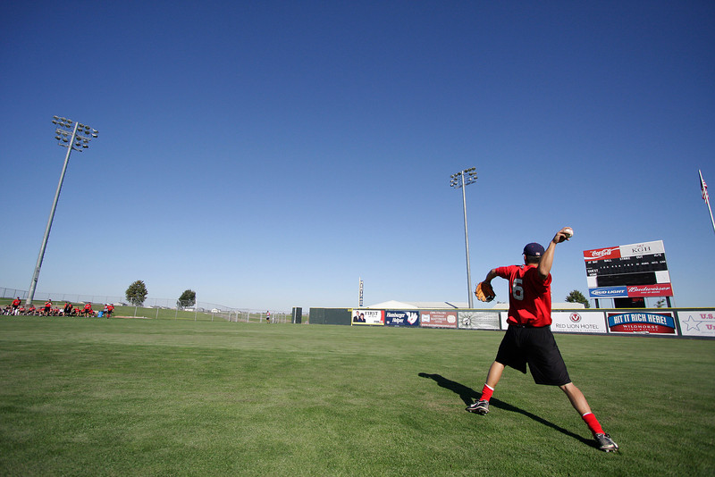 Spokane Indians second baseman Jason Ogata throws a ball during practice at Gesa Stadium, in Pasco, Wash., Monday, August 4, 2008. The Spokane Indians beat the Tri-City Dust Devils 13-9 that evening in a Northwest League game. (Young Kwak Special to the Pacific Northwest Inlander)