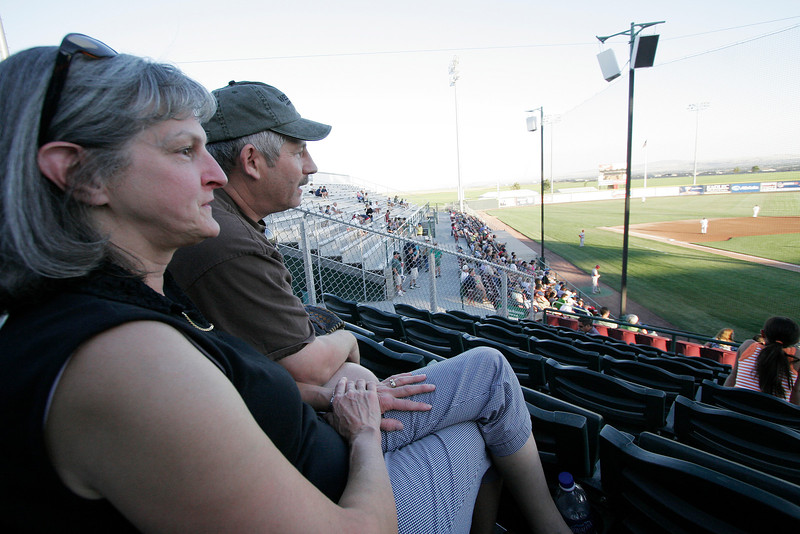 The Spokane Indians host family of Betty, left, and John White watch the Indians play the Tri-City Dust Devils in a Northwest League game at Gesa Stadium, in Pasco, Wash., Monday, August 4, 2008. The Whites host catcher Justin Pickett, outfielder Jared Bolden and outfielder Mike Bianucci. Host families provide accomodations, may provide some food and transportation for players, offering a home away from home for the players. The Spokane Indians beat the Tri-City Dust Devils 13-9 that evening in a Northwest League game. (Young Kwak Special to the Pacific Northwest Inlander)