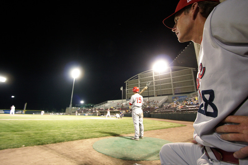 Spokane Indians manager Tim Hulett, Sr. watches from the dugout as catcher Justin Pickett warms up during a Northwest League game against the Tri-City Dust Devils at Gesa Stadium, in Pasco, Wash., Monday, August 4, 2008. The Spokane Indians beat the Tri-City Dust Devils 13-9 that evening in a Northwest League game. (Young Kwak Special to the Pacific Northwest Inlander)