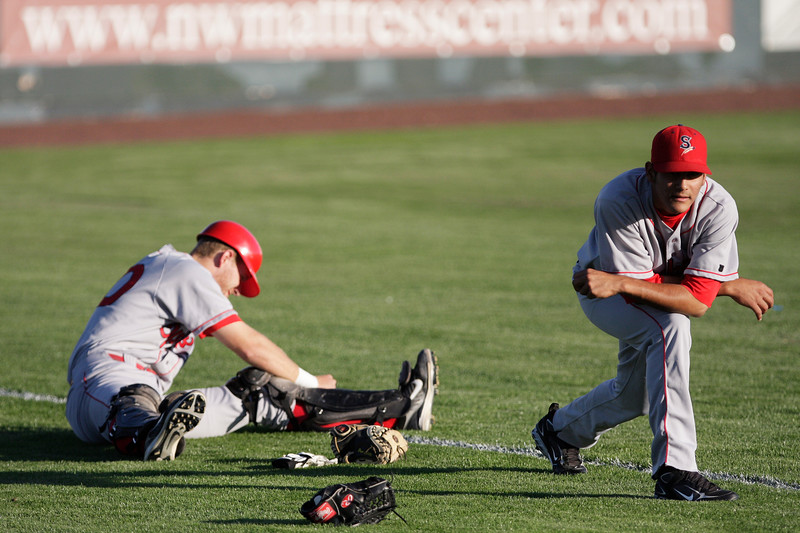 Spokane Indians catcher Doug Hogan, left, and pitcher Martin Perez stretch before a game against the Tri-City Dust Devils at Gesa Stadium, in Pasco, Wash., Monday, August 4, 2008. The Spokane Indians beat the Tri-City Dust Devils 13-9 that evening in a Northwest League game. (Young Kwak Special to the Pacific Northwest Inlander)