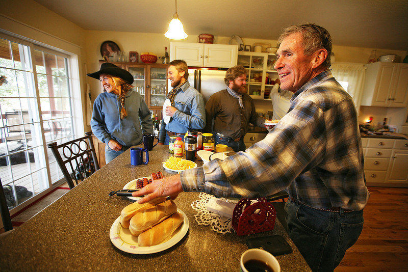 Dave Harris, right, Catlin Dix Harris, left, Cody Dix Harris and Nate Gutzwiller eat lunch at Lazy H Ranches, in Cheney, Wash., on Monday, November 7, 2011. (Young Kwak Special to the Pacific Northwest Inlander)