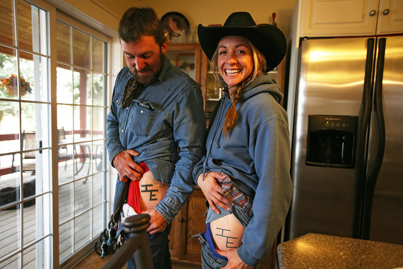 Cody Dix Harris, left, and his sister Catlin show their Lazy Ranches shwow their tattoos at Lazy H Ranches, in Cheney, Wash., on Monday, November 7, 2011. (Young Kwak Special to the Pacific Northwest Inlander)