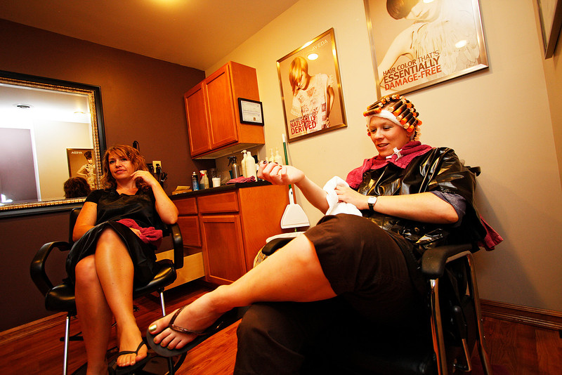 Amanda Webb waits for her perm to set as employee Rachel Anderson looks on at Moment Spa & Fitness in St. John, Wash. on Tuesday, July 6, 2010. The spa opened in Feb. 2009. Anderson, an Endicott, Wash. resident has worked at the spa since Jan. 2010. Webb, who grew up in Cheney, married Matt Webb and moved to St. John 11 years ago. Matt Webb grew up in the town. (Young Kwak Special to the Pacific Northwest Inlander)