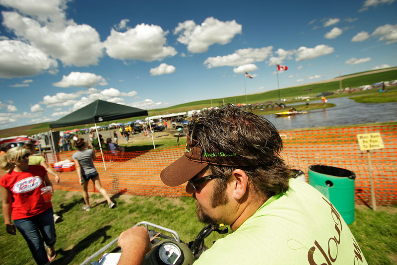 Organizer Matt Webb monitors issues riding his 4-wheeler during a United States Sprint Boat Association race at Webb's Slough in St. John, Wash. on Saturday, June 19, 2010. Thousands attended this event. (Young Kwak Special to the Pacific Northwest Inlander)