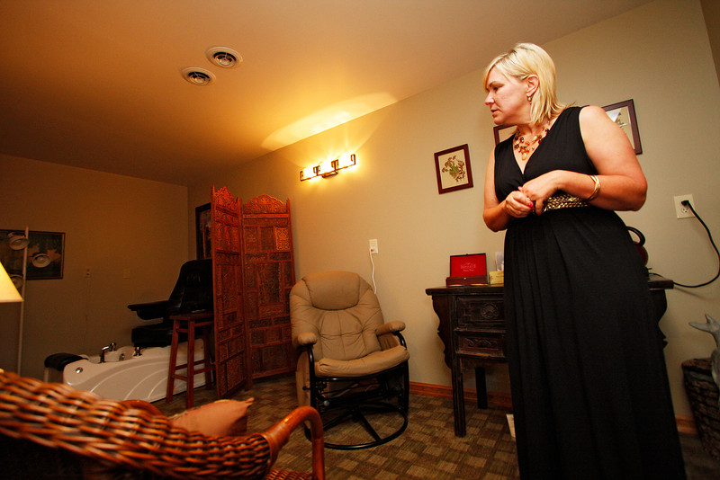 Employee Carrie Gossard shows the waiting room at Moments Spa & Fitness in St. John, Wash. on Tuesday, July 6, 2010. The spa opened in Feb. 2010. Gossard moved to St. John in 1990 from Colome, SD, after her husband got a job as a crop duster in town. (Young Kwak Special to the Pacific Northwest Inlander)