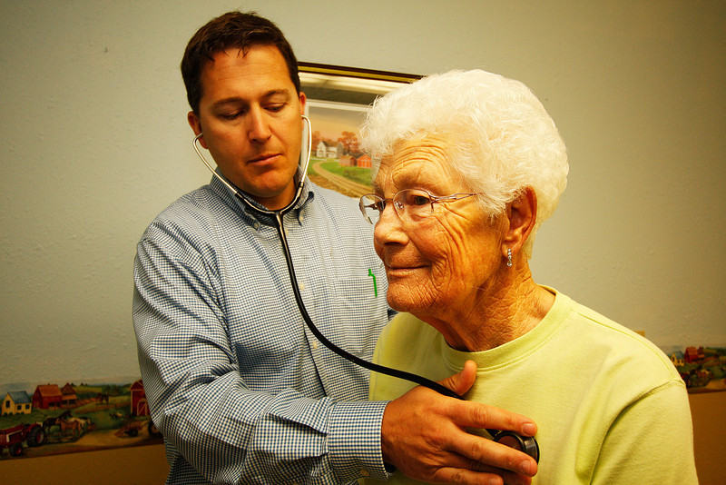 Town doctor Tony Lundberg, DO, examines 82 year old Billie Dechenne at Whitman Medical Group in St. John, Wash. on Tuesday, July 6, 2010. Dechenne's family has been in the region since the mid 1800s. (Young Kwak Special to the Pacific Northwest Inlander)
