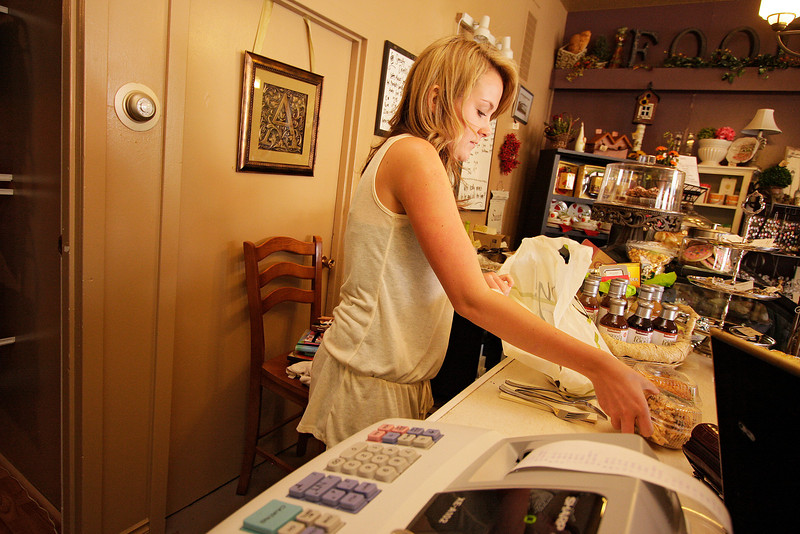 21 year old A la Carte employee Lauren Gordon bags some food in St. John, Wash. on Tuesday, June 29, 2010. Gordon lives in Spokane, Wash. most of the year, but visits her father for the summer in St. John. (Young Kwak Special to the Pacific Northwest Inlander)