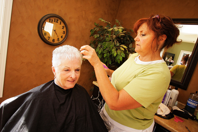 Owner Peg Curtis gives Dorothy McBride a haircut at St. John Salon in St. John, Wash. on Tuesday, June 29, 2010. Curtis has owned the salon for 22 years, recently moving into the current location. She met her ex-husband in Cheney, Wash. and moved back to his hometown with him after getting married. McBride frew up in St. John, left to live in Spokane, Wash. and then returned in 2006 after remarrying a St. John man following the death of her first husband. (Young Kwak Special to the Pacific Northwest Inlander)