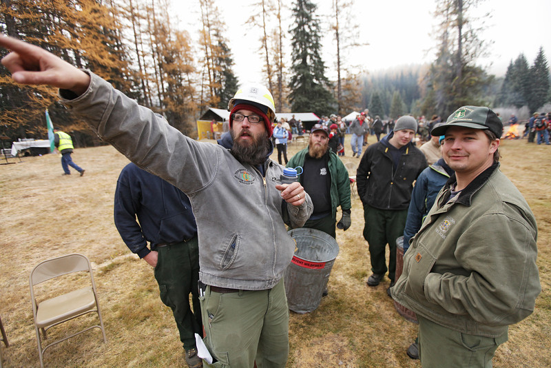 U.S. Forest Service employee Ben Curtis, center, reviews some procedures before an eighty-eight foot Engelmann Spruce, destined to be the U.S. Capitol Christmas Tree, is cut, in the Colville National Forest, in Pend Oreille County, Wash., on Friday, November 1, 2013. (Young Kwak/The Pacific Northwest Inlander)