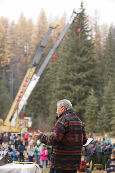 Kalispel Tribe Cultural Program Director Francis Cullooyah speaks before an eighty-eight foot Engelmann Spruce, destined to be the U.S. Capitol Christmas Tree, is cut in the Colville National Forest, in Pend Oreille County, Wash., on Friday, November 1, 2013. (Young Kwak/The Pacific Northwest Inlander)