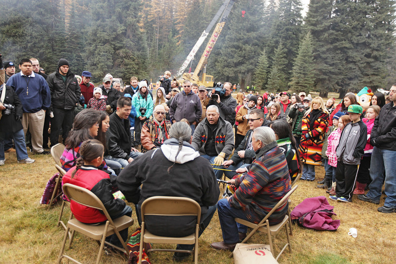 Members of the Kalispel Tribe perform a flag song and an honor song before an eighty-eight foot Engelmann Spruce, destined to be the U.S. Capitol Christmas Tree, is cut in the Colville National Forest, in Pend Oreille County, Wash., on Friday, November 1, 2013. (Young Kwak/The Pacific Northwest Inlander)