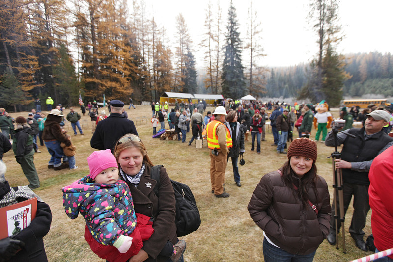 Sonia Wirth, left, holding her 20 month old daughter Sadie, and Stephanie Wirth wait for  an eighty-eight foot Engelmann Spruce, destined to be the U.S. Capitol Christmas Tree, is cut, in the Colville National Forest, in Pend Oreille County, Wash., on Friday, November 1, 2013. (Young Kwak/The Pacific Northwest Inlander)