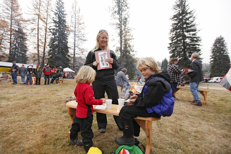 4 year old Maggie McClure, left, and her 7year old brother Connor eat cookies and drink hot chocolate, as their mother Erin watches, before an eighty-eight foot Engelmann Spruce, destined to be the U.S. Capitol Christmas Tree, is cut, in the Colville National Forest, in Pend Oreille County, Wash., on Friday, November 1, 2013. (Young Kwak/The Pacific Northwest Inlander)