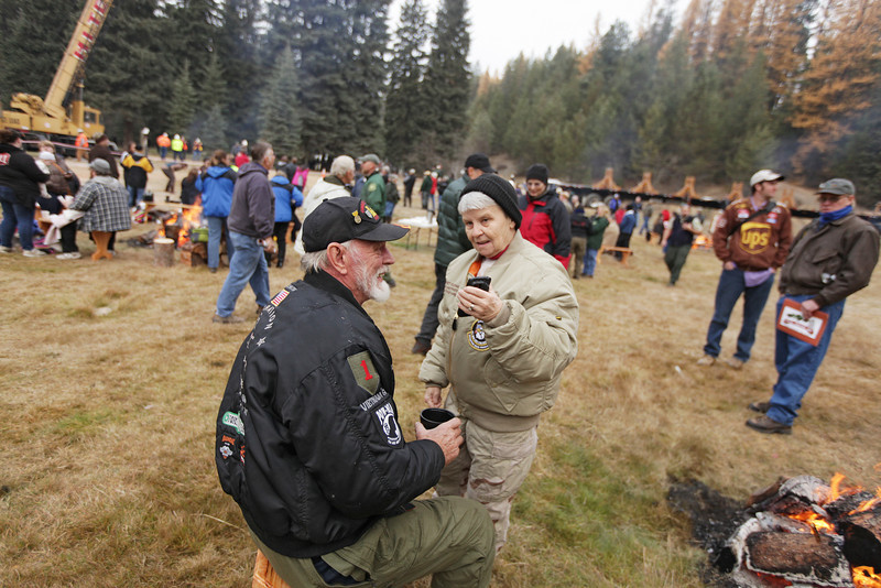 Margaret Schmidt, right, shows her husband Dennis a photo before an eighty-eight foot Engelmann Spruce, destined to be the U.S. Capitol Christmas Tree, is cut, in the Colville National Forest, in Pend Oreille County, Wash., on Friday, November 1, 2013. (Young Kwak/The Pacific Northwest Inlander)