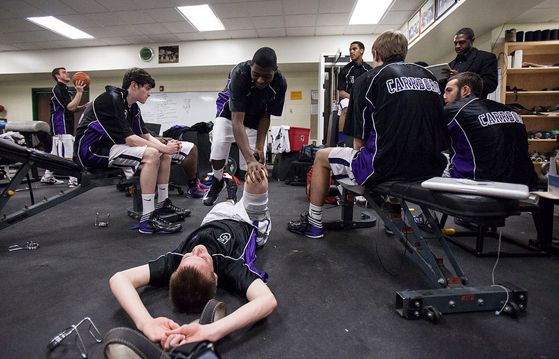 The team stretches and prepares themselves before a game. They take care of one another and treat one another as brothers. They are a tight knit team and family, and before every game take the opportunity to spend time together as a group. They are always together.