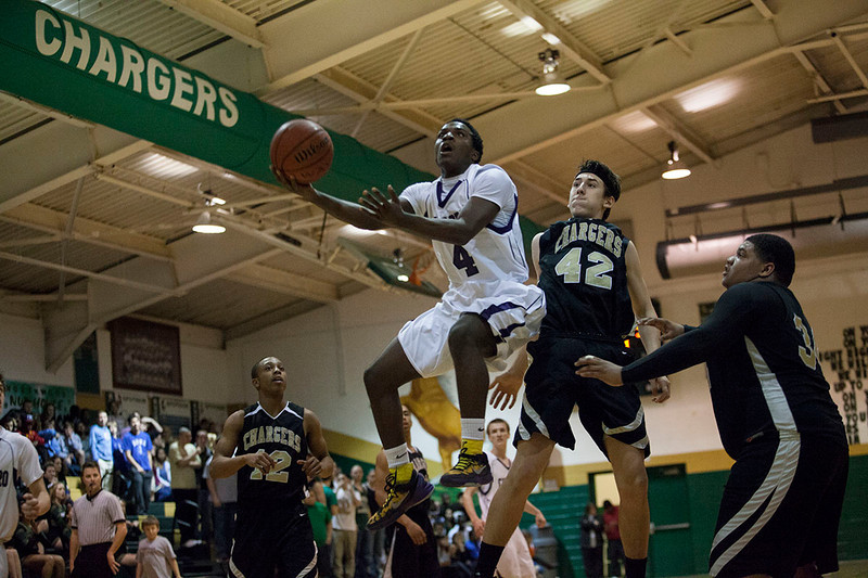 Trai Sharp goes in for a basket at Northwood High School in Pittsboro. The gym was packed on that Friday night with Carrboro fans making the drive to support their team in the conference championship.