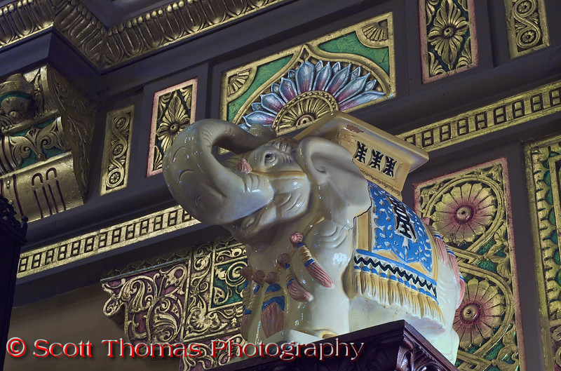 A porcelain elephant in the lower lobby greets patrons leaving the orchestra level theatre exits. Elephants are symbolic of commitment and strength in Asian culture.