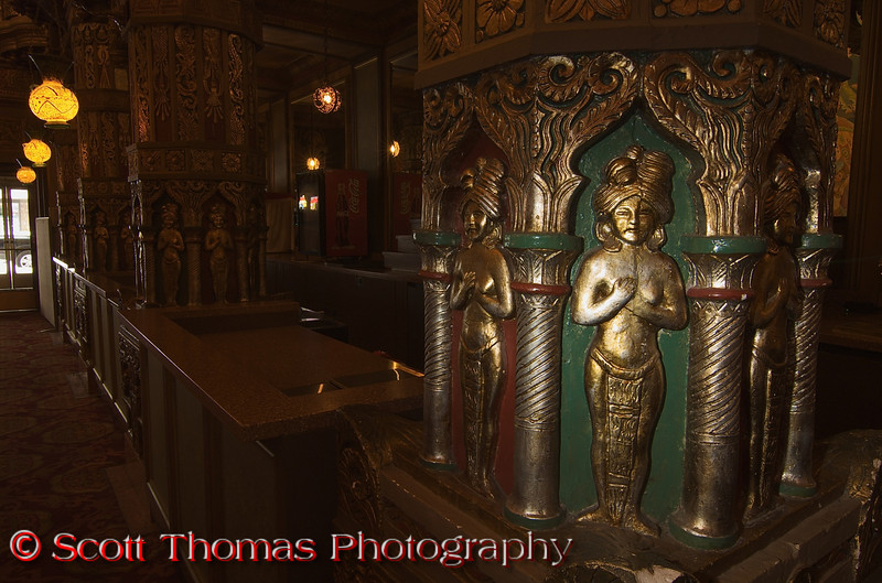 """Across from the grand mural is the Landmark Theatre concession area with pillars featuring exotic looking women.  I wanted to focus on one of the pillars and used an off camera flash technique thanks to Nikon's Creative Lighting System (CLS).  I set my camera to rear sync flash mode and an 8 second exposure which I found to give a darkened look to the scene.  I set my <a href=""""http://www.amazon.com/exec/obidos/ASIN/B0002EMY9Y/ref=nosim/allinaname/"""" target=""""new"""">Nikon SB-600 Speedlight</a> to it's maximum zoom and aimed it at the closest pillar.  With my camera on a tripod I tripped the shutter with the <a href=""""http://www.amazon.com/exec/obidos/ASIN/B00007EDZG/ref=nosim/allinaname/"""" target=""""new"""">Nikon ML-L3 Wireless Remote</a> and just before the shutter closed, the flash fired.  My aim was good as the figure on the pillar is nicely illuminated yet you can still see detail and lighting in the background.  To learn more about the Nikon CLS, check out Joe McNally's latest book, <a href=""""http://www.amazon.com/exec/obidos/ASIN/0321580141/ref=nosim/allinaname/"""" target=""""new""""><i>The Hot Shoe Diaries: Big Light from Small Flashes</i></a>."""