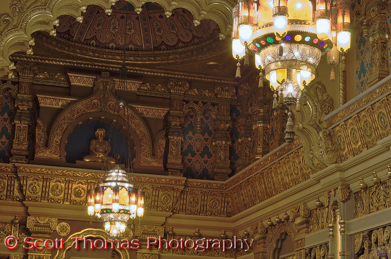 """The Buddha is known to Buddhists as the """"awakened"""" or """"enlightened"""" one and is featured in many things Asian.  Thomas Lamb used Buddhas throughout the Landmark Theatre lobby.  Some can only be seen from certain angles.  This one is only visible from the lower lobby as you enter the main entrance or the mezzanine level."""