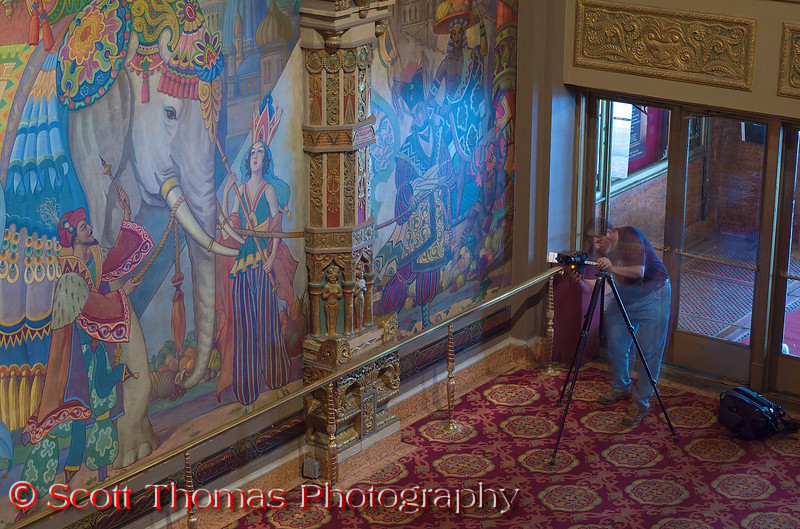"""A fellow photographer from the <a href=""""http://www.meetup.com/Syracuse-Photographers-Association/"""" target=""""new"""">Syracuse Photographers Association meetup group</a> lines up a shot in the lobby of the Landmark Theatre.  Though flash was allowed, tripods proved to be a valuable tool in capturing all the detail found in the Landmark."""