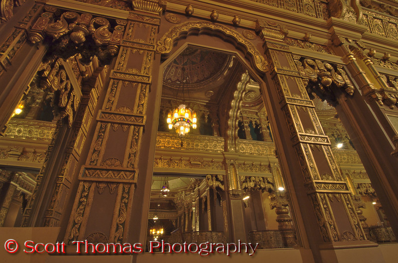 High ceilings, gold and bronzed carvings, tall mirrors and colorful chandeliers add to the majesty of the Landmark Theatre's lobby.