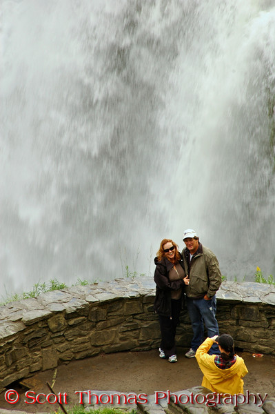 Tourists getting photographed with the Middle Falls behind them in the overlook you saw in the last picture.
