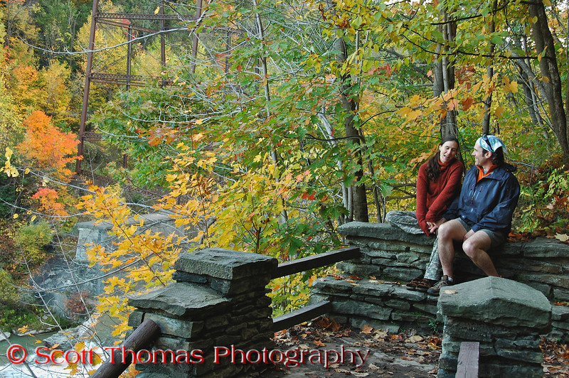 A couple takes a break from climbing the stone stairs above the Upper Falls.  There are literally thousands of steps constructed throughout the park.