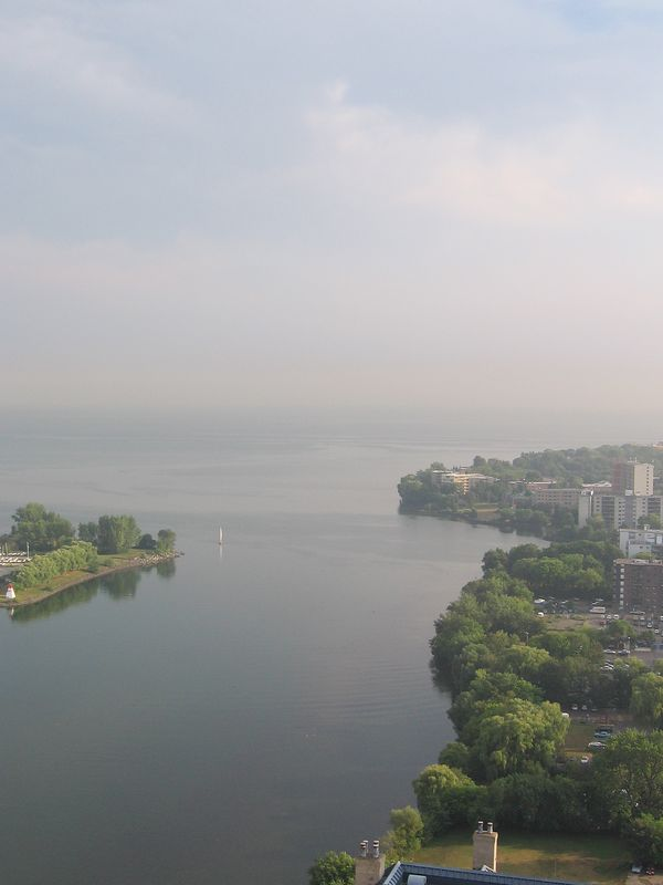 Looking southeast toward Hamilton, you can see the Mimico shoreline. Sailboats are heading out from the marina.