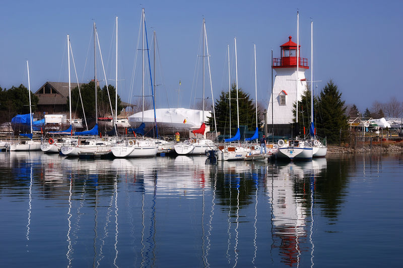 Mimico Marina's lighthouse and boats from the Humber College Sailing School.