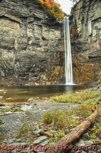 """There is always two photos of a scene, one horizontal (landscape) and one vertical (portrait).  Especially when you are taking a photo of a tall subject like the Taughannock Falls.  Here I <a href=""""http://land.allears.net/blogs/photoblog/2009/03/ready_327_hyperhollywood.html"""" target=""""new"""">used hyperfocus</a> to keep everything in focus from front to back.  This is the way sweeping landscapes are shot.  I wonder when the tree you see at the bottom of the frame went over the falls?  Bet that made an extra big splash!"""