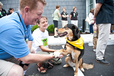 Committed volunteer for 17 years, Jason McCarthy, offers his hand to greet an equally friendly four-legged guest.