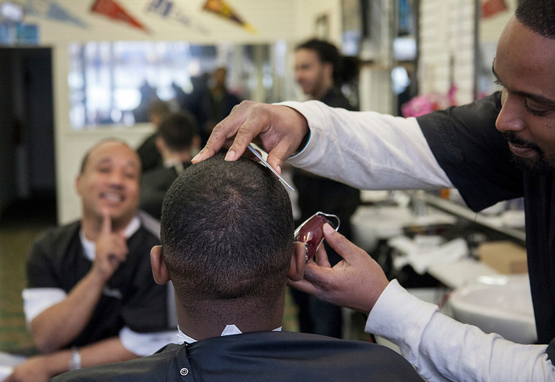 Krisp Kutz, a barbershop located in downtown Sanford, is owned by Roshon Robles, seen on the right. The barbershop is fairly new to the downtown scene, but it doesn't lack the small town barbershop feel. Friends gather and spend hours talking while men come in and out to get their haircut.