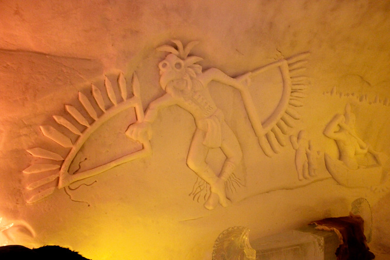 indigenous carving on the wall of a room in the ice hotel