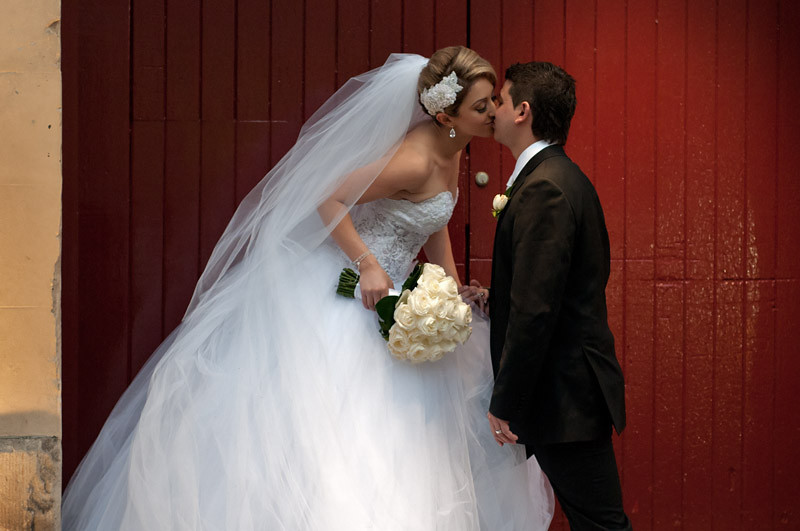A kiss, as per the photographer's instructions