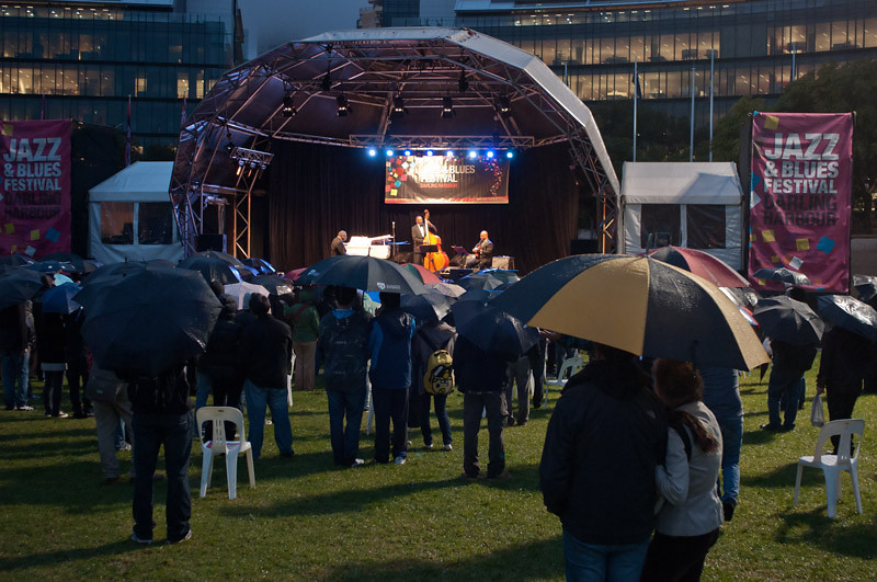 Standing and enjoying the Ron Carter Trio even under the rain!...