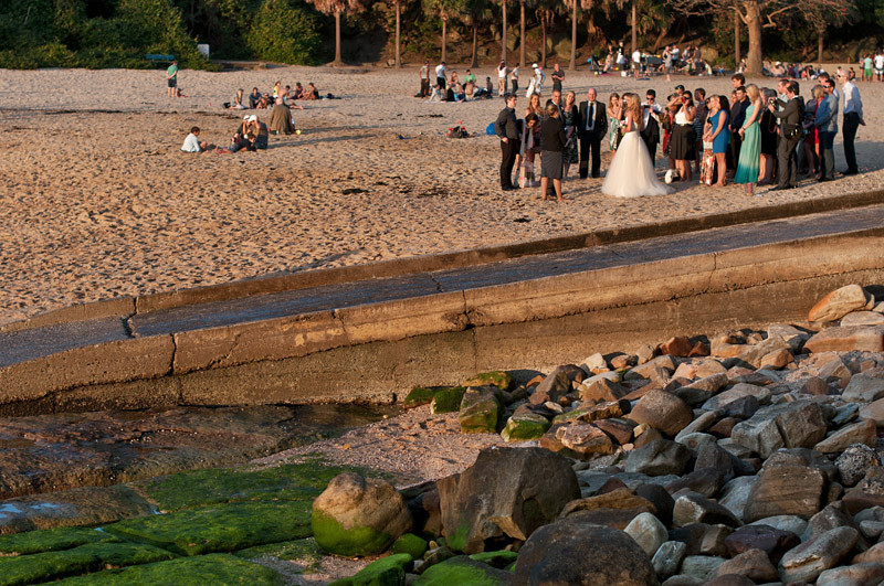 Wedding shots by the beach, capturing the last rays of the setting sun