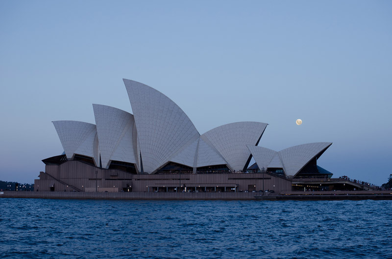 Dusk and an almost full moon over the Opera house