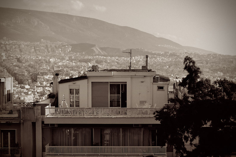 View from the foots of the Lycabettus hill. If you pay close attention you will notice a man standing by the open window of the top floor of the opposite house, holding his camera towards my side