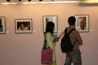 "Visitors to the ""Below the Poverty Line"" photography exhibition of Suchit Nanda's images held from 25th to 30th September, 2007 at the Drik Gallery, Dhaka. The exhibition was part of a series of activities carried out under UNESCO's Artist in Development Programme funded by the Norwegian Ministry of Foreign Affairs (Norwegian Embassy). Suchit is a majority world photographer and regularly contributes to http://www.majorityworld.com/"