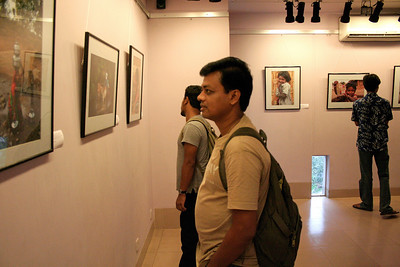 "Visitors to the photographic exhibition ""Below the Poverty Line"" - a photography exhibition of Suchit Nanda's images held from 25th to 30th September, 2007 at the Drik Gallery, Dhaka. The exhibition was part of a series of activities carried out under UNESCO's Artist in Development Programme funded by the Norwegian Ministry of Foreign Affairs (Norwegian Embassy). Suchit is a majority world photographer and regularly contributes to http://www.majorityworld.com/"