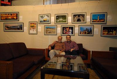 Swapan Mukherjee with Suchit Nanda with pictures of Suchit Nanda exhibited behind @ Rodas Hotel, Powai, Mumbai, India.