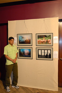 Venky in front of his pictures exhibited at the Rodas Hotel, Powai, Mumbai.